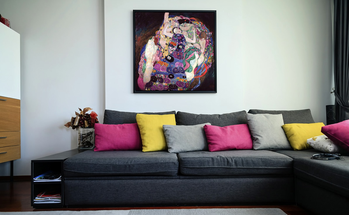 Sofa, colored cushions and Gustav Klimt's painting.